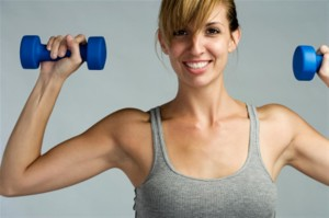 Female with weights, working out.